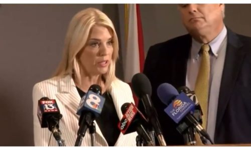Pam Bondi standing at a podium during a press conference | Adam Horowitz Law